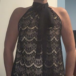 Sleeveless blouse. Black lace over gold tank